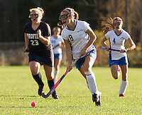 Gilford's Becky Zakorchemny takes control of the ball during NHIAA Division III Field Hockey Friday afternoon.  (Karen Bobotas/for the Laconia Daily Sun)