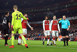 19 December 2017 -  EFL Cup (1/4 Final) - Arsenal v West Ham United - Referee Kevin Friend shows a yellow card to Joe Hart of West Ham - Photo: Marc Atkins/Offside