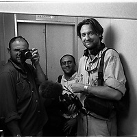 The team waiting to get into Afghanistan, 1999. (Greg Marinovich (left) , Joao Silva (centre), Dominic Cunningham-Reid (right) in an elevater that often stuck in Dushanbe, Tajikistan. (Greg Marinovich)