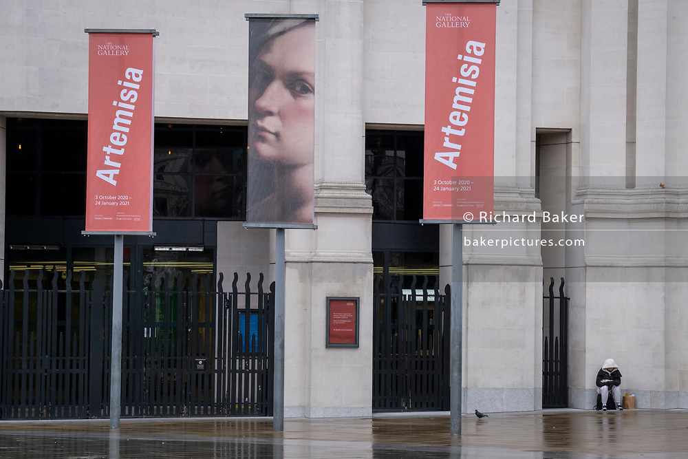 The day after the government introduced a third Coronavirus pandemic national lockdown, effectively a Tier 5 restriction, as the capital experiences a grim post-Christmas and millions of Britons are told to stay at home, on 5th January 2021, in London, England. The banners are for the current art exihibition of Italian Baroque artist, Artemisia Gentileschi.