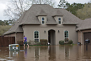 Covington Louisiana, March, 12, 2016,  A residnet in Tallow Creek subdivision surveys the floodwaters that continued to rise on Saterday afternoon..14 inches of rain fell in less than 24 hours, after three days of intermittent rain, causing flash floods. The Tchefuncte River and Bogue Falaya River<br />  crested on Saturday morning but the flood event continued into the night for those in Tallow Creek.