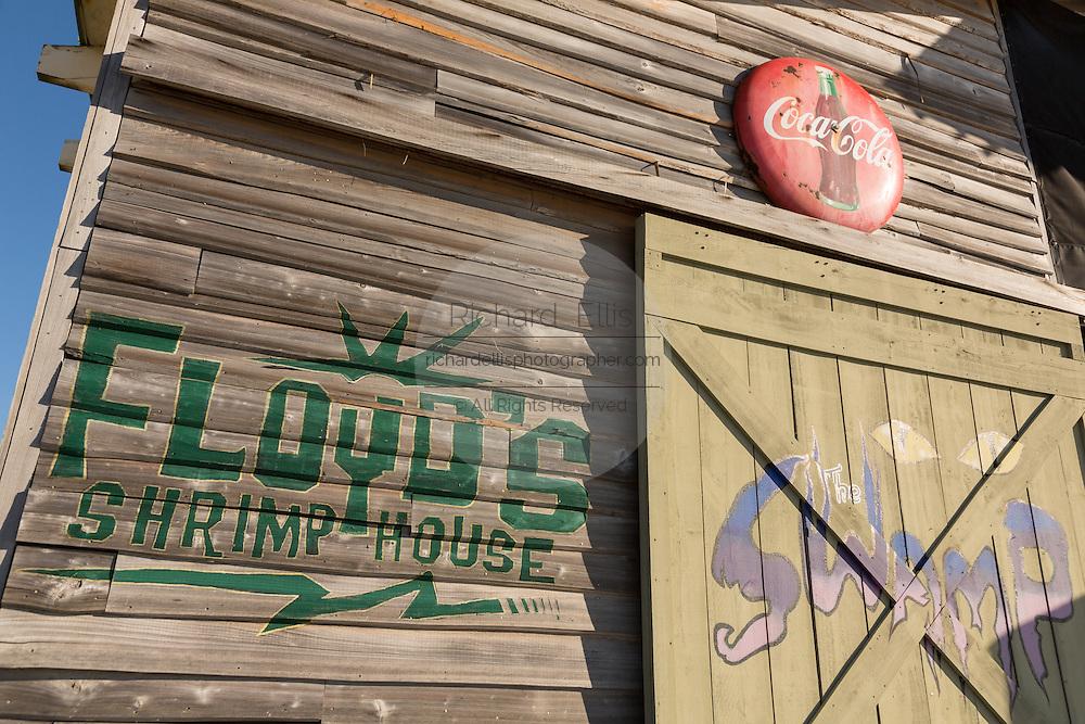 Floyd Shrimp House sign on the beach in Fort Walton Beach, Florida.