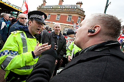 © licensed to London News Pictures. Hyde, UK  25/02/2012. Police argue with BNP organisers who demonstrate within line of sight of the town's larger mosque. The EDL demonstrate following an assault on Daniel Stringer-Prince. The victim's family said they did not want the EDL to demonstrate in their town in their son's name. It is alleged he was assulted by a gang of Asian men. At the same time, the BNP hold a rally in the town. Photo credit should read Joel Goodman/LNP
