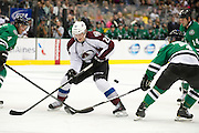 DALLAS, TX - SEPTEMBER 26:  Nathan MacKinnon #29 of the Colorado Avalanche loses control of the puck against the Dallas Stars in an NHL preseason game on September 26, 2013 at the American Airlines Center in Dallas, Texas.  (Photo by Cooper Neill/Getty Images) *** Local Caption *** Nathan MacKinnon