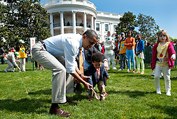 U.S. President Barack Obama watches as a child rolls Easter eggs during the White House Easter Egg Roll on the South Lawn of the White House in Washington, D.C. on April 09, 2012. Photo by Kevin Dietsch/Pool/ABACAPRESS.COM  | 316169_001 Washington Etats-Unis United States