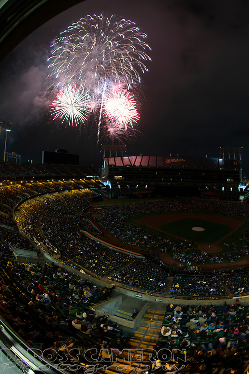 Fireworks explode over the Oakland-Alameda County Coliseum following an Oakland Athletics baseball game, Wednesday, July 3, 2019, in Oakland, Calif. (Photo by D. Ross Cameron)
