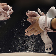 Gymnasts chalk their hands in preparation for practice  during a final training session before the start of The 2013 P&G Gymnastics Championships, USA Gymnastics' national championships which runs from Thursday until Sunday at the XL, Centre, Hartford, Connecticut.<br /> The event features gymnasts in both the junior and senior divisions. Performances will determine all-around and individual event national champions, as well as the national team for the junior and senior elite levels. Hartford, Connecticut, USA. 14th August 2013. Photo Tim Clayton
