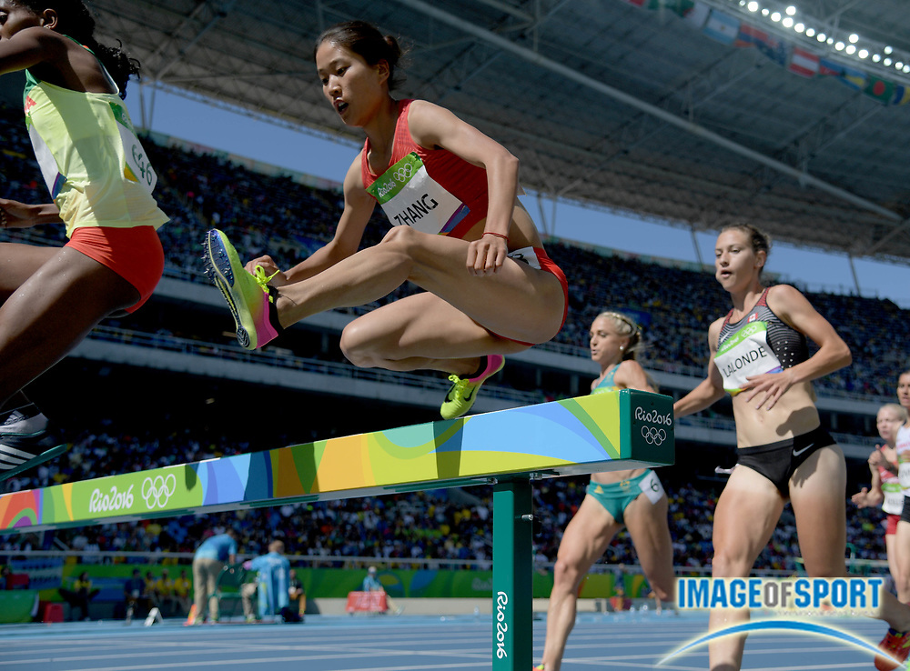 Aug 13, 2016; Rio de Janeiro, Brazil; Xinyan Zhang (CHN) competes in the women's 3000m steeplechase  event at Estadio Olimpico Joao Havelange during the Rio 2016 Summer Olympic Games.