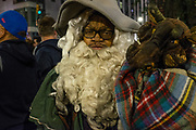 New York, NY - 31 October 2019. the annual Greenwich Village Halloween Parade along Manhattan's 6th Avenue. A bearded man costumed as a wizard with a pet dragon.
