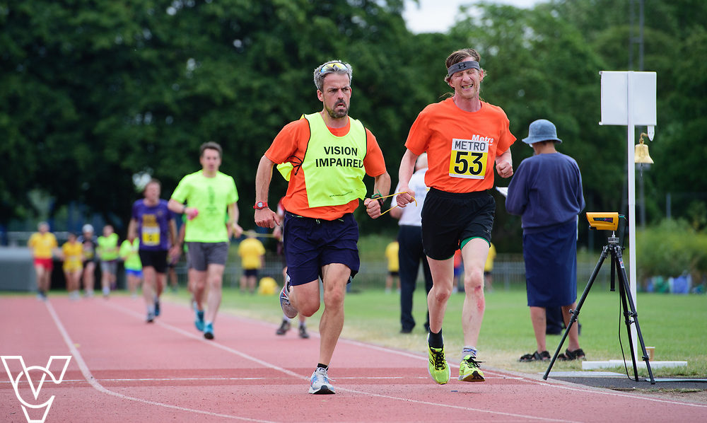 Event: 5000 meter relay<br /> Competitors, from left: Neil Foster<br /> <br /> Metro Blind Sport's 42nd Athletics Open, held at Mile End Stadium, Tower Hamlets, London.<br /> <br /> Picture: Chris Vaughan Photography for Metro Blind Sports<br /> Date: June 16, 2018