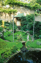 Oriental style garden showing use of water and bamboo screen