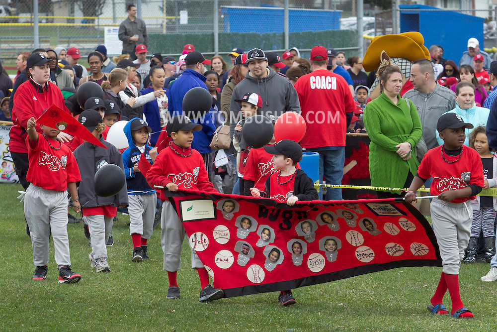 Middletown, New York - Children and adults march onto a baseball field in the 60th annual Middletown Little League parade on April 14, 2013.