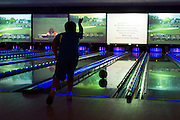 Max Schultz (8) bowls during the 6th annual Zweig Family End of School Year Bash at 300 Dallas in Addison on Sunday, April 14, 2013. (Cooper Neill/The Dallas Morning News)