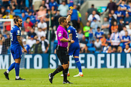 YELLOW CARD Cardiff City forward Isaac Vassell  (14) is shown a yellow card by referee Joshua Smith during the EFL Sky Bet Championship match between Cardiff City and Bournemouth at the Cardiff City Stadium, Cardiff, Wales on 18 September 2021.