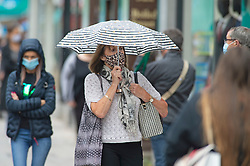 ©Licensed to London News Pictures 24/09/2020  <br /> Bromley, UK. Umbrellas up. Wet and windy weather today for shoppers in Bromley High Street, Bromley, South East London. The next two day are expected to bring thunder and gales to the UK. Photo credit:Grant Falvey/LNP