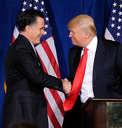 Feb. 2, 2012 - Las Vegas, Nevada, U.S.-  Republican presidential candidate, former Massachusetts Gov. MITT ROMNEY (L) and DONALD TRUMP shake hands during a news conference held by Trump to endorse Romney for president at the Trump International Hotel & Tower. Romney came in first in the Florida primary on January 31 and is looking ahead to Nevada's caucus on February 4. (Credit Image: © David Becker/ZUMAPRESS.com)