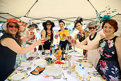 Racegoers enjoy a bite to eat during day two of Royal Ascot at Ascot Racecourse.