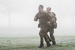 Windsor, UK. 31st January, 2019. Soldiers train in frosty and foggy conditions alongside the Long Walk in Windsor Great Park. There are two barracks in Windsor, the Victoria Barracks which currently houses the 1st Battalion Coldstream Guards and the Combermere Barracks which houses the Household Cavalry Regiment. Freezing fog patches are expected to clear slowly in south-east England during the morning, to be followed by cloud, sleet and snow in the east.