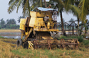 PEASANT FARMING, Malaysia. Combine harvester. Kedah state. World Bank funded  project. Poor farmers, peasants, planting, harvesting, cultivating rice padi.