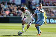 Ki Sung-Yueng of Swansea city is challenged by Marko Arnautovic of Stoke city ®. Premier league match, Swansea city v Stoke City at the Liberty Stadium in Swansea, South Wales on Saturday 22nd April 2017.<br /> pic by Andrew Orchard, Andrew Orchard sports photography.
