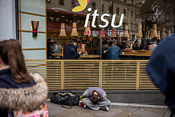 FILE IMAGE © Licensed to London News Pictures. 21/10/2019. London, UK. A homeless man outside Itsu's in the Strand, known for its many restaurants, cafès, bars and theatre nightlife. Pictures highlight the reality of homelessness in Westminster taken during the build up of Brexit and the General election just a few hundreds yards from Parliament and Downing Street. Photo credit: Alex Lentati/LNP