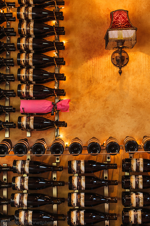 Wine bottles line the wal at Hard Row to Hoe Vineyards in Manson, Washington.