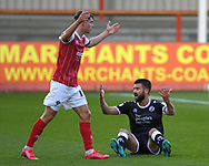 George Francomb (4) of Crawley Town and George Lloyd (19) of Cheltenham Town during the EFL Sky Bet League 2 match between Cheltenham Town and Crawley Town at Jonny Rocks Stadium, Cheltenham, England on 10 October 2020.