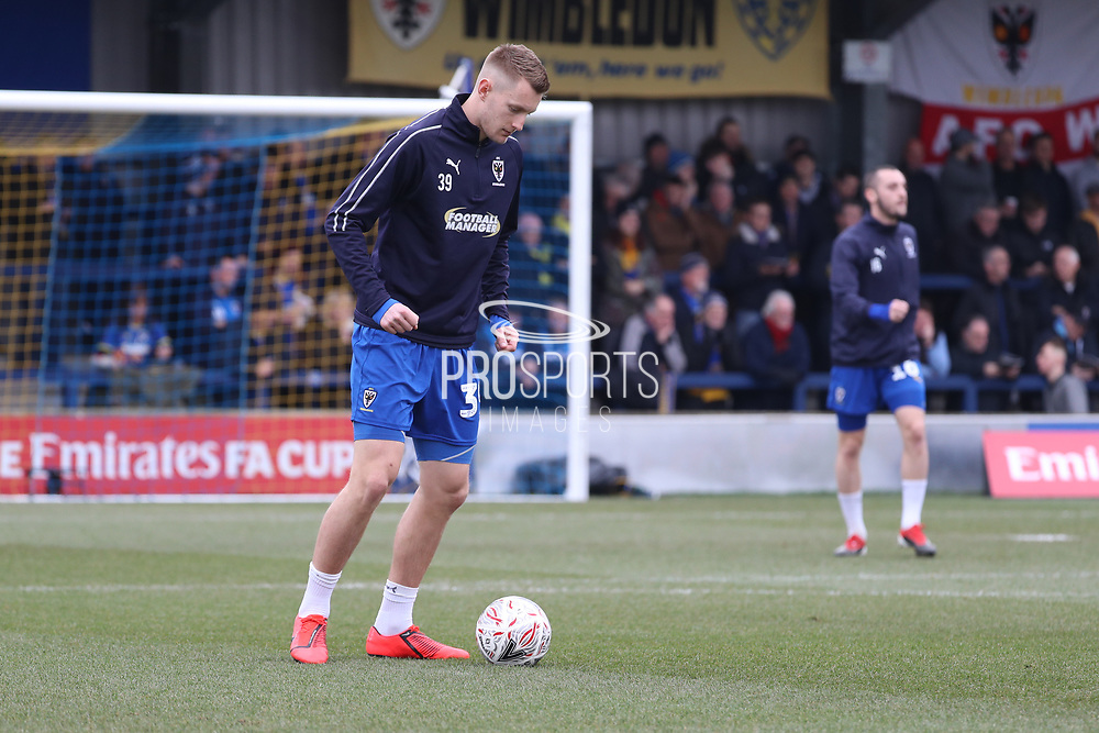 AFC Wimbledon striker Joe Pigott (39) and AFC Wimbledon midfielder Dylan Connolly (16) warming up during the The FA Cup 5th round match between AFC Wimbledon and Millwall at the Cherry Red Records Stadium, Kingston, England on 16 February 2019.