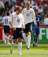Photo: Chris Ratcliffe.<br /> England v Paraguay. Group B, FIFA World Cup 2006. 10/06/2006.<br /> Michael Owen and Peter Crouch of England.
