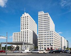 Modern office building with Ritz Carlton Hotel on left at Potsdamer Platz in Berlin, Germany
