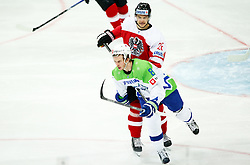 Ziga Jeglic of Slovenia vs Stefan Bacher of Austria in action during ice hockey match between National Teams of Austria and Slovenia in 5th Round of 2016 IIHF Ice Hockey World Championship Division 1 - Group A, on April 29, 2016 in Spodek Arena, Katowice, Poland. Photo by Marek Piuyzs / Sportida