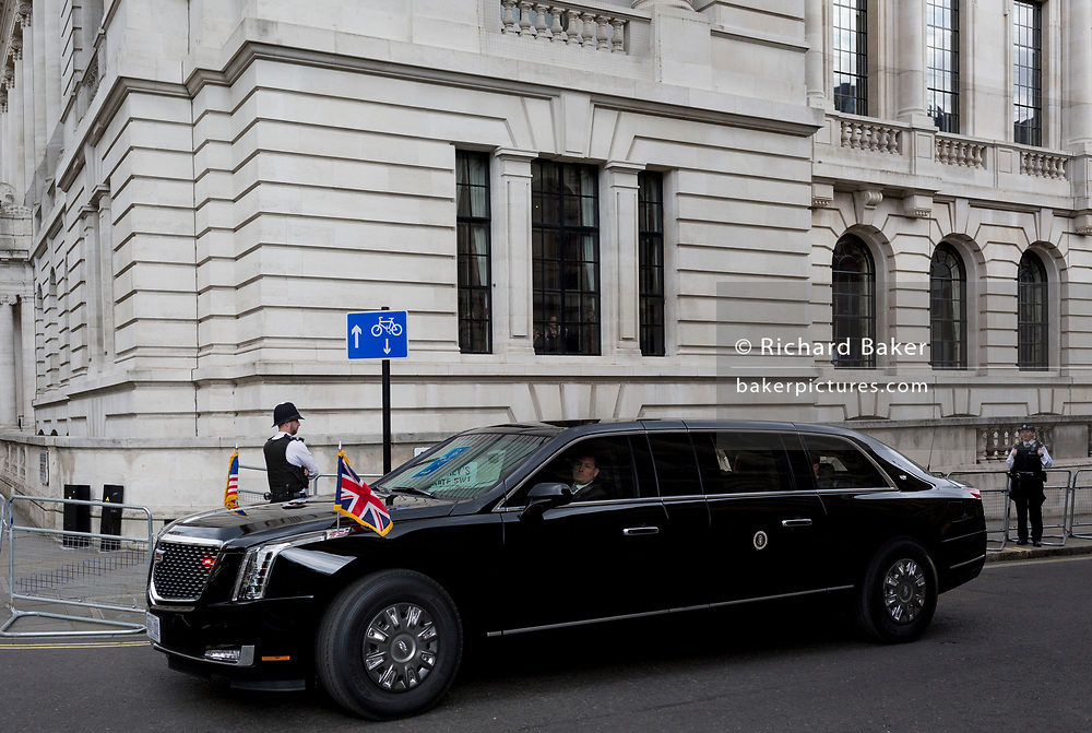 On US President Donald Trump's first day of a controversial three-day state visit to the UK by the 45th American President, his Presidential cavalcade makes its way along Horseguards en-route to Westminster Abbey, on 3rd June 2019, in London England. The armour-plated car, formerly named Cadillac One, is understood to cost around £1.1million and weighs at least four tonnes. 'The Beast' is flown to whichever country the US president is visiting and is reportedly armed with tear gas canisters, pump-action shotguns a life support machine and blood supply.