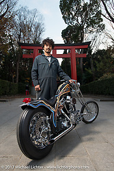 """Cherry's Company'sKaichiroh """"Kross"""" Kurosu's with his custom 1949 Harley-Davidson Panhead in front of a Torii Gate at a Shinto Shrine near his shop. Thursday December 7, 2017. Photography ©2017 Michael Lichter."""
