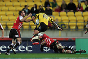 Hurricanes second five Ma'a Nonu leaps into a tackle. Super 15 rugby match - Hurricanes v Lions at Westpac Stadium, Wellington, New Zealand on Saturday, 4 June 2011. Photo: Dave Lintott / photosport.co.nz