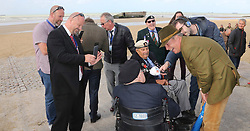© Licensed to London News Pictures. 06/06/2017. Normandy, France. Former leader of UKIP, NIGEL FARAGE speaks to a group of WW2 veterans, all in their 90's, during a visit to Arromanches Beach in Normandy, France to mark the anniversary of the D-Day landings on June 1944.. Photo credit: Jason Bryant/LNP