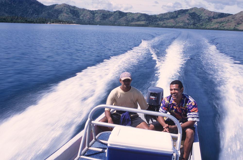 Fiji Islands, Nukubati Island Resort, staff in speed boat