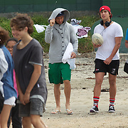 Quade Cooper arrives with locals for the Australian teams recovery session at  Takapuna Beach at the IRB Rugby World Cup tournament, Auckland, New Zealand, 17th October 2011. Photo Tim Clayton...