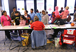 September 10, 2017 - Albany, GA, USA - Local residents fill the lobby to check in to the Red Cross shelter at the Albany Civic Center to ride out Hurricane Irma on Sunday, Sept. 10, 2017, in Albany, Ga. (Credit Image: © Curtis Compton/TNS via ZUMA Wire)