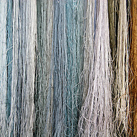 Asia, China, Suzhou. Colorful silk strands of thread for embroidery.