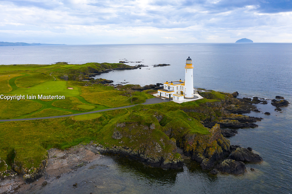 Aerial view of lighthouse at 9th green on Ailsa golf course at Trump Turnberry resort in Ayrshire, Scotland, UK