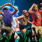 "WASHINGTON, DC - October 2nd, 2014 - Big Freedia (right, with mic) performs at the Howard Theatre in Washington, D.C.  Freedia is credited with bringing New Orleans ""bounce music"" to the masses. His latest album, Just Be Free, was released in June. (Photo by Kyle Gustafson/For The Washington Post)"