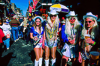 """Dallas Cowboy Cheerleaders"" in the French Quarter on Fat Tuesday, Mardi Gras, New Orleans, Louisiana USA"