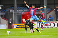 Funso Ojo of Scunthorpe United (6) and Lewis O'Brien of Bradford City (39) during the EFL Sky Bet League 1 match between Scunthorpe United and Bradford City at Glanford Park, Scunthorpe, England on 27 April 2019.