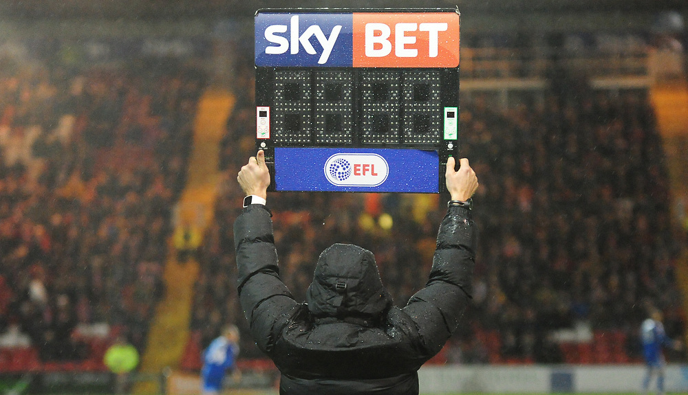 Fourth official Ricky Wootton holds aloft the LED board<br /> <br /> Photographer Andrew Vaughan/CameraSport<br /> <br /> The EFL Checkatrade Trophy - Northern Section Group G - Lincoln City v Notts County - Tuesday 7th November 2017 - Sincil Bank - Lincoln<br />  <br /> World Copyright © 2018 CameraSport. All rights reserved. 43 Linden Ave. Countesthorpe. Leicester. England. LE8 5PG - Tel: +44 (0) 116 277 4147 - admin@camerasport.com - www.camerasport.com