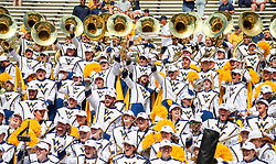 Sep 4, 2021; College Park, Maryland, USA; Members of the West Virginia Mountaineers band cheer before their game against the Maryland Terrapins at Capital One Field at Maryland Stadium. Mandatory Credit: Ben Queen-USA TODAY Sports