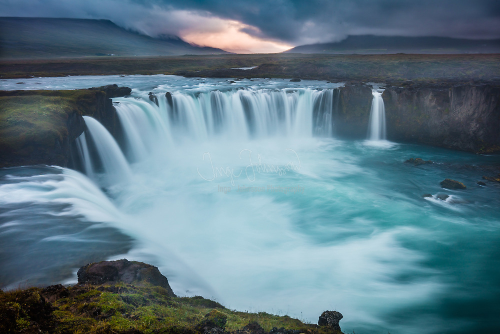 """The Goðafoss (Icelandic: """"waterfall of the gods"""" or """"waterfall of the goði"""") is a waterfall in Iceland. It is located in the Bárðardalur district of Northeastern Region at the beginning of the Sprengisandur highland road. The water of the river Skjálfandafljót falls from a height of 12 meters over a width of 30 meters. The river has its origin deep in the Icelandic highland and runs from the highland through the Bárðardalur valley, from Sprengisandur in the Highlands.<br /> <br /> In the year 999 or 1000 the lawspeaker Þorgeir Ljósvetningagoði made Christianity the official religion of Iceland. According to a modern myth, it is said that upon returning from the Alþingi, Þorgeir threw his statues of the Norse gods into the waterfall. The story of Þorgeir's role in the adoption of Christianity in Iceland is preserved in Ari Þorgilsson's Íslendingabók. """"Íslendingabók"""", however, makes no mention of Þorgeir throwing his idols into Goðafoss. A window in Akureyrarkirkja, the Cathedral of Akureyri, illustrates this story."""