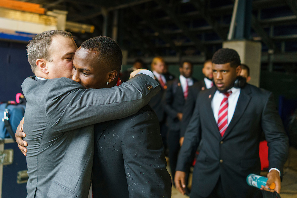Annapolis, Maryland - October 08, 2016: Tom Herman, the University of Houston's head coach, hugs and kisses  Linell Bonner, junior wide receiver before their game against Navy, in Annapolis, Md., Saturday October 8, 2016.<br /> <br /> <br /> Before every game, Tom Herman, the University of Houston's head coach, hugs and kisses each of his players during the walk from the bus to the locker room .<br /> <br /> The Cougars lost their first game of the season to the Midshipmen 40 - 46.<br /> <br /> <br /> CREDIT: Matt Roth for The New York Times<br /> Assignment ID:  30196504A