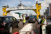Crew staff direct traffic as it boards the Woolwich Ferry on the River Thames on October 05, 2018 in London, England on the final day of operation with the old boats.  The Woolwich ferry river crossing service closes from Saturday 6th October until the end of the year to allow new pontoons to be constructed for new boats and the ferry is planned to resume at the end of the year.