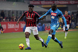 January 26, 2019 - Milan, Milan, Italy - Frank Kessie #79 of AC Milan competes for the ball with Kalidou Koulibaly #26 of SSC Napoli during the serie A match between AC Milan and SSC Napoli at Stadio Giuseppe Meazza on January 26, 2018 in Milan, Italy. (Credit Image: © Giuseppe Cottini/NurPhoto via ZUMA Press)