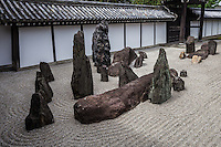 """Tofukuji South Garden, in front of the Hojo is the most contrived work among the four gardens and is composed of rock compositions symbolizing Elysian islands - from the east to the west named """"Eiju, Horai, Koryo, and Hojo"""" - placed on the sand garden floor """"Hakkai"""" meaning the eight seas and five moss covered sacred mountains at the western end.  The garden was designed by renowned landscape architect Mirei Shigemori and considered to be one of his most important and representative works."""